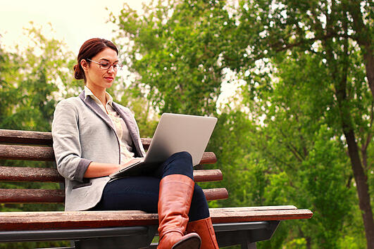 Woman-reviewing-sustainable-information-technology