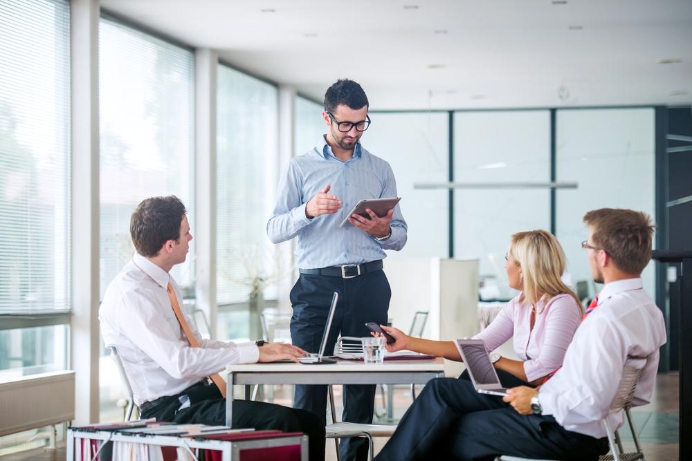 Board meeting in a modern office.jpeg