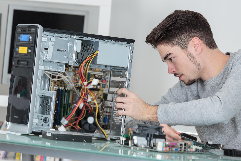 Technician repairing hard drive.